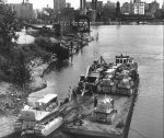 1930s Photo of Caterpillar Bulldozers being loaded onto an Illinois River Barge