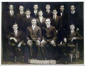 "January 2020 Mystery Photo - Photo of group of men with sign ""Morton 13"""